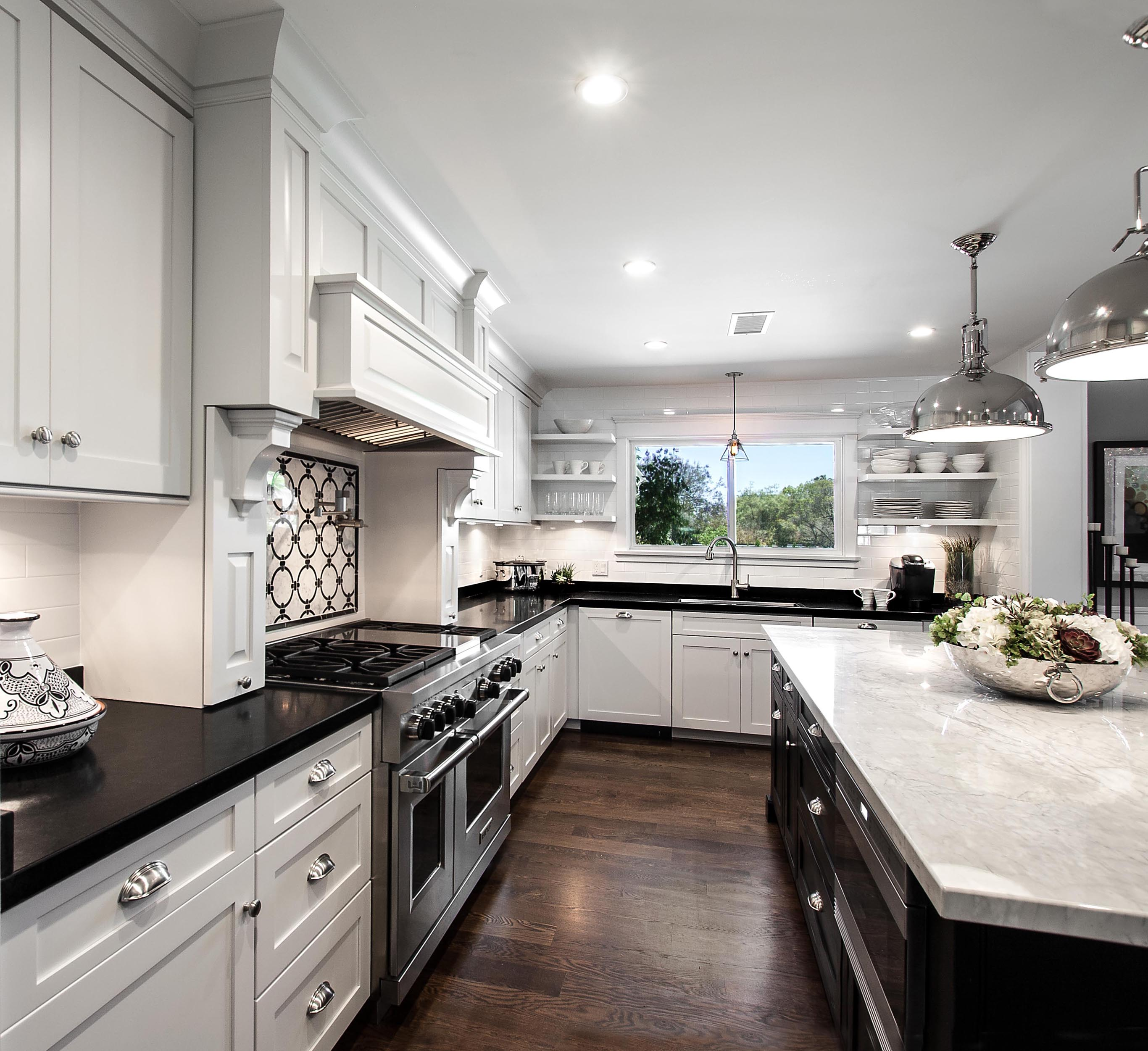 White Kitchen Cabinetry with Black Countertops